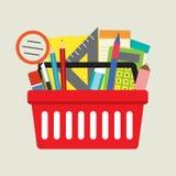 Fournitures scolaires dans le panier Image libre de droits