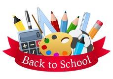 Fournitures scolaires et ruban rouge Photos stock