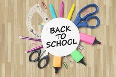 Fournitures scolaires sous le papier rond Images stock