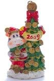 fourrure décorative de vache à Noël de bougie près d'arbre Photos libres de droits