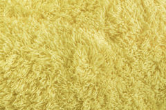 Fourrure jaune de texture de tissu Photographie stock