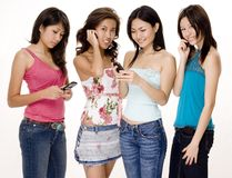 Foursome #4. Four pretty young asian women using their phones Stock Image