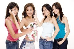 Foursome #5. Four beautiful young asian women using cellphones Stock Photography