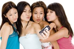 Foursome #7. Four attractive young women pucker-up for the camera on the phone Stock Images