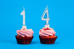 Fourteen on cakes Royalty Free Stock Images