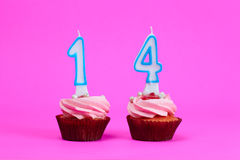 Fourteen on cakes a Royalty Free Stock Photo