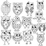 Fourteen cartoon funny owl outlines. Set of fourteen cartoon ornate amusing owl outlines with big eyes isolated on the white background, vector illustration Stock Images