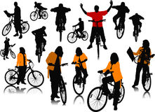 Fourteen  people silhouettes with bicycle Stock Photo