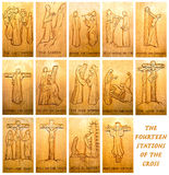 The Fourteen Stations Of The Cross. Wooden carvings of showing the fourteen stations of the Cross royalty free stock photo