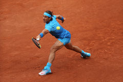 Fourteen times Grand Slam champion Rafael Nadal in action during his second round match at Roland Garros 2015 Royalty Free Stock Image