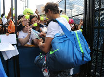 Fourteen times Grand Slam champion Rafael Nadal of Spain signing autographs after practice for US Open 2015 Stock Photography