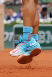 Fourteen times Grand Slam champion Rafael Nadal wears custom Nike tennis shoes during second round match at Roland Garros Stock Images