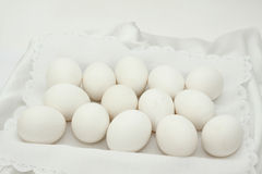 Fourteen white eggs Stock Photo