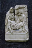 Fourteenth Station of Via Dolorosa, The Sepulcher. Fourteenth Station of Via Dolorosa Carvings, Ivory attached on Granite Base, seen in Bedono Church Central Stock Image