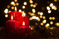 Fourth advent, candles in atmospheric light. Four red candles with christmas balls in atmospheric light Stock Photos