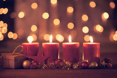 Fourth advent. Christmas decoration with christmas bauble and candle for advent season four candles burning Royalty Free Stock Image
