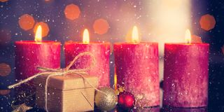Fourth advent. Christmas decoration with christmas bauble and candle for advent season four candles burning Royalty Free Stock Photos