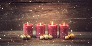 Fourth advent. Four candles decorated with christmas balls burning , concepts for fourth advent stock photo