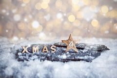 Fourth Advent Sunday and wooden XMAS letters in snow stock images