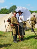 The Fourth International Historical Festival. Times and Epochs 1914-2014, Kolomenskoye, Moscow. 8th of June, 2014. A military man with a woman-photographer Royalty Free Stock Image