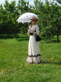 The Fourth International Historical Festival Times and Epochs 1914-2014, Kolomenskoye, Moscow. 8th of June, 2014. A walking lady in the garden Stock Photo
