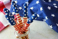 Fourth of July American flag pretzel rods in a jar Stock Photo