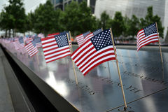 Fourth of July. American Flags placed along at the 9/11 Memorial in Lower Manhattan in celebration of the Fourth of July Stock Image