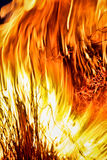 Fourth of July bonfire. Close up image of a burning pine branch in a Fourth of July (U.S. Independence Day) celebration. Image shows the intense orange, yellow royalty free stock photography