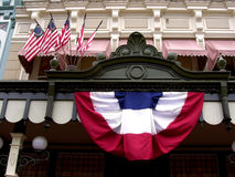 Fourth of July Bunting. A photograph of a building with patriotic bunting and flags stock photo