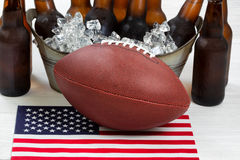 Fourth of July celebration with football and ice cold beer Royalty Free Stock Photography