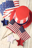 Fourth Of July Display. High angle shot of assorted items to celebrate the Fourth of July. Items include, Uncle Sam Hat, American Flags, napkins and red white royalty free stock photography