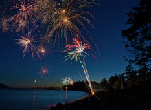 Fourth of July Fireworks. On a beach in the San Juan Islands of Puget Sound, Washington, the fireworks add a special element to the celebration of USA's stock photo