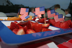 Fourth of July Fruit Plate. Strawberries and melons with American flags in a blue and white platter stock photo