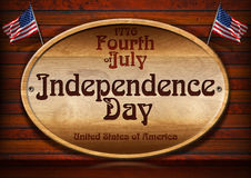 1776 Fourth of July Independence Day. Wooden plaque on wooden wall with two US flags and the inscription: 1776 - Fourth of July Independence Day - United States Royalty Free Stock Image