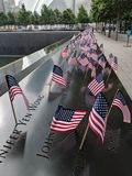 Fourth of July in New York City. American flags at the 9/11 Memorial in honor of the Fourth of July in Lower Manhattan stock photo