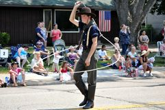 Fourth of July Parade. RICHFIELD - JULY 4:  A Young Cowboy performs rope tricks in the 2012 Fourth of July Parade in Richfield, Minnesota Royalty Free Stock Images