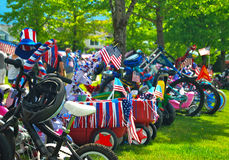 Fourth July Parade Bikes. Small town America celebrates 4th of July with kids parade of decorated bikes and wagons Stock Photography