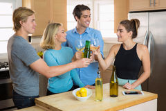 Fourth of July party with a group of friends buddies toasting beers and having a house party celebration for fun together Stock Photography