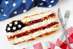 Fourth of July pastry with holiday decor on white wood Stock Photography