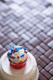 Fourth of July Star Cupcakes. A Fourth of July cupcake decorated with red, white and blue star sprinkles Royalty Free Stock Images
