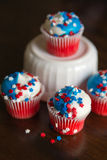 Fourth of July Star Cupcakes. Four Fourth of July cupcakes decorated with red, white and blue star sprinkles Stock Photos