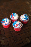 Fourth of July Star Cupcakes. Four Fourth of July cupcakes decorated with red, white and blue star sprinkles Royalty Free Stock Photography