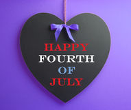 Fourth of July, USA America holiday, celebration message on heart shape blackboard Royalty Free Stock Photo