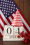 Fourth of July vintage wood calendar with flag background. Royalty Free Stock Images
