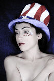 Fourth of July Woman. Beautiful model representing the patriotic colors of the United States of America Royalty Free Stock Photo