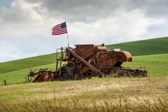 Free Fourth Of July Patriotism On An Old Harvester. Stock Image - 153158341