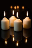 Fourth sunday in advent, candles with black background Stock Image
