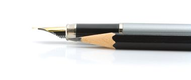 Foutain pen and black pencil. Ofiice suplies - foutain pen and black pencil on a white background stock photo