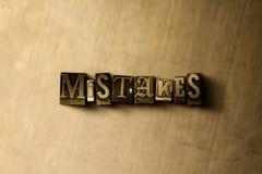FOUTEN - close-up van grungy wijnoogst gezet woord op metaalachtergrond Stock Afbeeldingen