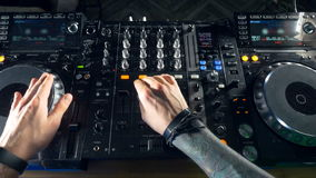 FOV. Disco and Club DJ hands mixing at night club party. stock video footage